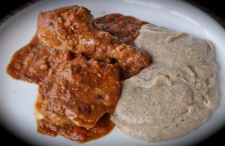 chicken with Catalan picada with a side of polenta taragna