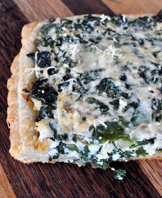 savory tart with ricotta and baby leafy greens