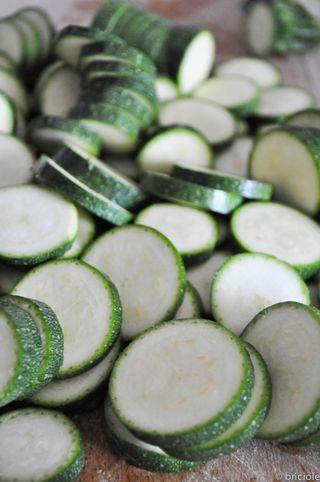 sliced zucchini on cutting board