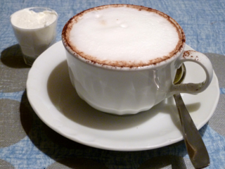 cappuccino with whipped cream on the side