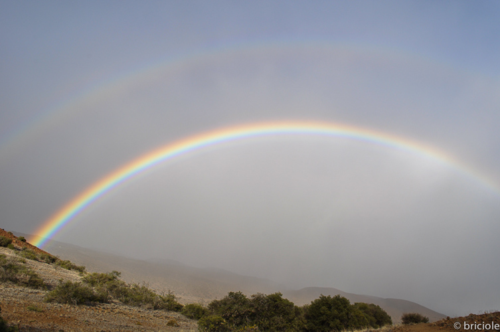 rainbow over Mauna Kea VIS Big Island Hawaii