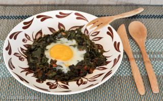 eggs nested in leafy green vegetables